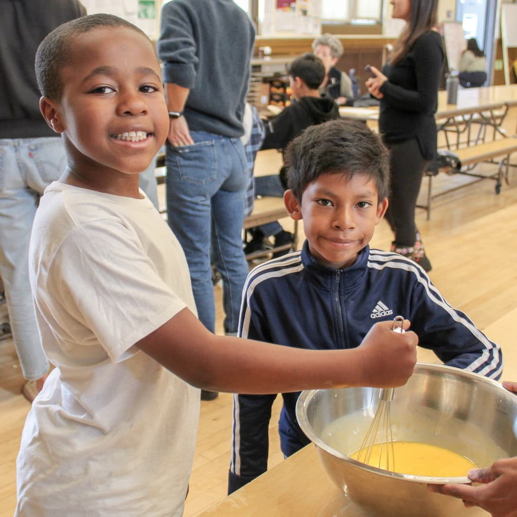 Children cooking in the Cooking Matters program